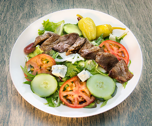 Barreh salad, consisting of meat and cucumbers, tomatoes, peppers, and cheese