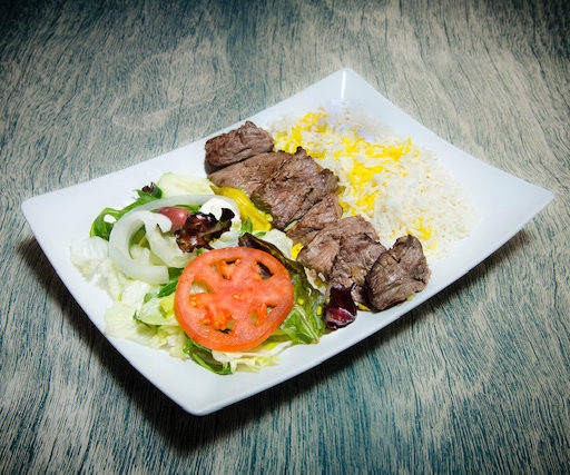 Chenjeh or Barreh with rice and salad